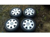 vw polo alloys x4 very good tyres nearly new. all with center caps
