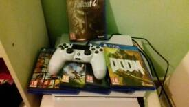 Slim white PS4 with 5 games, controller and headset