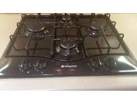 Black Hotpoint gas hob nearly new and in full working order.