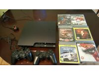 Play Station 3 for sale (in good condition) with games and remotes