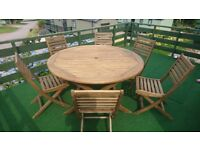 LARGE OUTDOOR TABLE WITH 6 CHAIRS TO MATCH...GREAT CONDITION