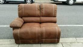 Half of brown fabric recliner sofa