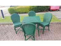 Large wicker table and 4 wicker chairs.