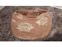 Russell and Bromley Brand light Brown Leather Handbag with embroidered front
