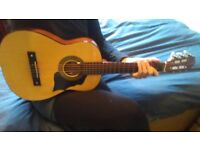 Half size guitar, perfect for kids and travellers, recently restrung.
