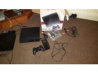 Ps3 console whit 2 controllers gta 5 and 4 more games