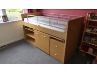 Childs cabin bed with integrated steps, desk, desk seat, shelves and drawers