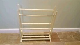 Shoe stand . Towel rail