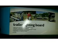 Trailer number plate board