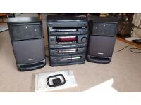 Aiwa stereo system: turntable, 3 CD changer, radio and double cassette player, plus speakers.