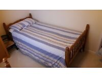 Single pine bed with clean good condition mattress.