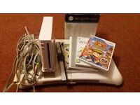 Nintendo Wii for sale with sport board and accessories and games