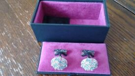 T. M. Lewin blue, pink, silver coloured cufflinks in black presentation box.