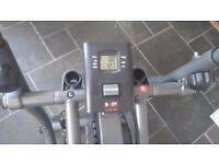 cross trainer with lcd display and adjustable tension wheel