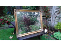 Large mirror with ornate gold frame in very good condition
