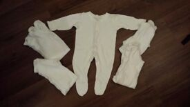 5 x White sleepsuits (0-3 months)