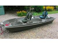 FISHING BOAT WITH OUTBOARD MOTOR AND FISH FINDER