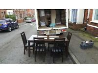 Dark oak wood dining room table & 5 oak and black leather chairs £75