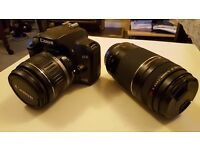 Canon 1000D DSLR camera with two lenses