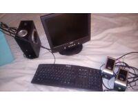 Dell flat panel monitor, keyboard, speakers, Boom Box
