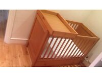 Childs cot with under storage and change table option in very good condition