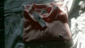 Men's lacoste pink polo shirt size 4 which is large ..