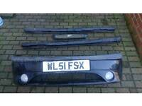 Ford fiesta mk4 zetec s black front bumper with spot lights, side skirts and grill