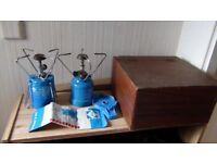 2 camping stoves with gas cans plus wooden chest