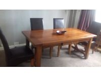 Sokid oak dining table and 4 faux leather chairs