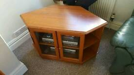 Wooden T.V cabinet with glass doors