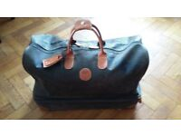 BRIC'S weekend holdall in brown leather with tan trim and brass detail