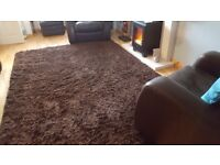 Two shaggy pile dark brown rugs in excellent condition.