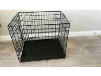 Collapsible dog crate.