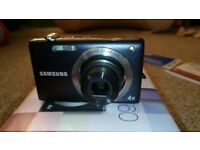 Samsung ST60 Smart Camera. 12.2 Megapixel, 4x Optical Zoom. Boxed, incl instructions, Charger etc