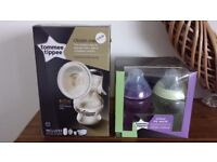 Tommee Tippee Manual Breast Pump not used and box of 4 260ml bottles never used