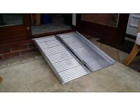 Portable Aluminium Folding Mobility Ramp Suitcase Style with Handle. Holds up to 270 kilos.