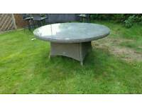 Round Hartman rattan garden glass top table