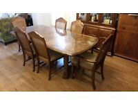 Large dark wood dining table with six chairs