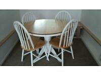 Lovely extending dining table and chairs