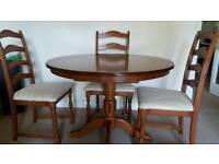 Round, Dark wood table and 4 chairs