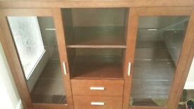 walnut sideboard with glass doors and shelving with interior lights