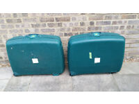 Pair of Delsey suitcases hard sided with wheels
