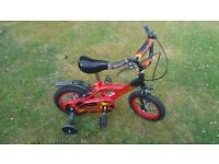 Childrens bike with stabilisers in excellent condition