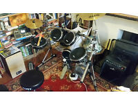 Alesis DM 10 drum kit, amp and extras.