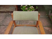 Upholstered in beige office chair with padded back rest