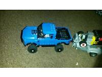 Ford raptor and hot rod car and trailer