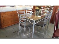 Glass dining table and 4 metal leather cushion chairs