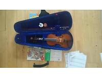 Violin 3/4 size with 4 music book, chin rest and new rosin.