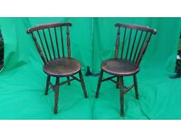 A pair of farmhouse dark wood chairs