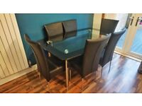 Glass dining table with 6 seats